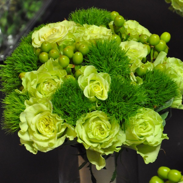 Green roses hypericum berries and green trick dianthus make up this